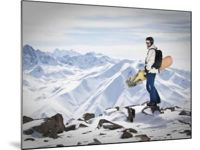 A Snowboarder at the Summit of Mount Affawat in Gulmarg, Kashmir, India-Julian Love-Mounted Photographic Print