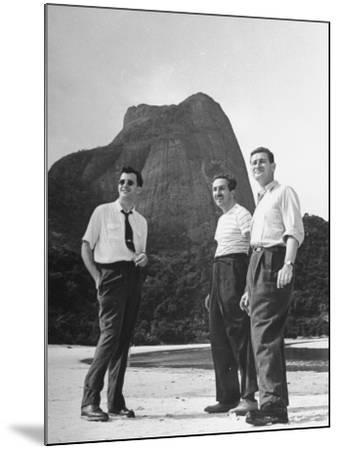 Artist Franklin Thomas Standing with Walt Disney on Brazilian Beach--Mounted Photographic Print