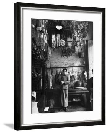 A Butcher Showing His Wares in His Shop--Framed Photographic Print