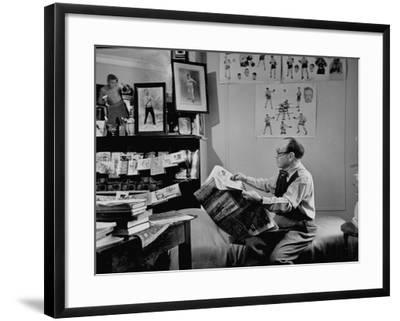 Charlie Goldman in His Room Reading the Newspaper--Framed Photographic Print