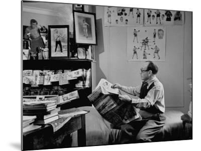 Charlie Goldman in His Room Reading the Newspaper--Mounted Photographic Print