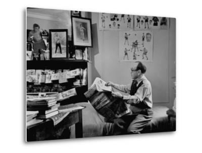 Charlie Goldman in His Room Reading the Newspaper--Metal Print