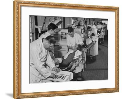 Dentists Working on Soldiers at the Ft. Meade and Walter Reed Dental Hospital--Framed Photographic Print