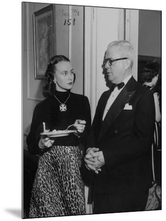 """Mrs. Austine Cassini and James K. """"Jake"""" Vardaman Talking During a Social Function--Mounted Photographic Print"""