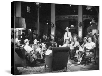 Cattle Men and Natives of San Angelo Sitting in the Lobby of the Cactus Hotel--Stretched Canvas Print