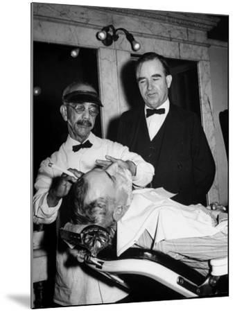 Representative Ned Patton Watching Barber at Work in the House Barber Shop--Mounted Photographic Print