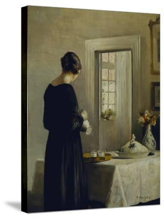 An Interior with a Woman at a Table-Carl Holsoe-Stretched Canvas Print