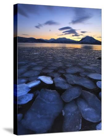 Ice Flakes Drifting Towards the Mountains on Tjeldoya Island, Norway-Stocktrek Images-Stretched Canvas Print
