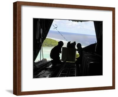 Airmen Push Out a Pallet of Donated Goods from a C-130 Hercules-Stocktrek Images-Framed Photographic Print