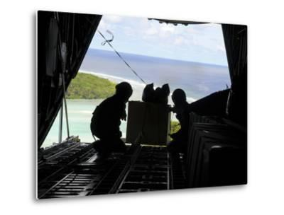 Airmen Push Out a Pallet of Donated Goods from a C-130 Hercules-Stocktrek Images-Metal Print