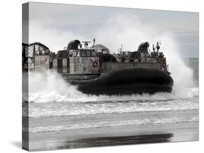 U.S. Navy Landing Craft Air Cushion Makes a Beach Landing-Stocktrek Images-Stretched Canvas Print