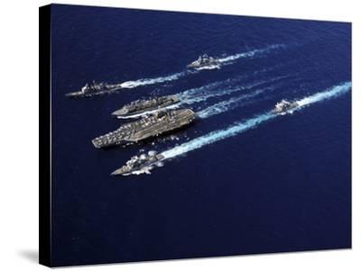 The Abraham Lincoln Carrier Strike Group Ships Cruise in Formation in the Pacific Ocean-Stocktrek Images-Stretched Canvas Print