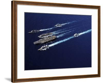 The Abraham Lincoln Carrier Strike Group Ships Cruise in Formation in the Pacific Ocean-Stocktrek Images-Framed Photographic Print