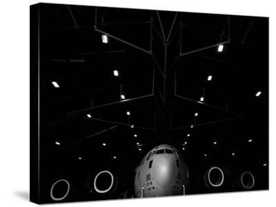A C-17 Globemaster Iii Sits in a Hangar at Mcchord Field Air Force Base, Washington-Stocktrek Images-Stretched Canvas Print