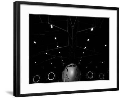 A C-17 Globemaster Iii Sits in a Hangar at Mcchord Field Air Force Base, Washington-Stocktrek Images-Framed Photographic Print