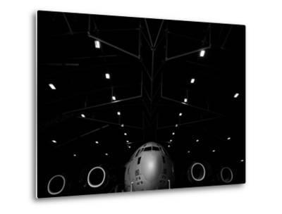 A C-17 Globemaster Iii Sits in a Hangar at Mcchord Field Air Force Base, Washington-Stocktrek Images-Metal Print