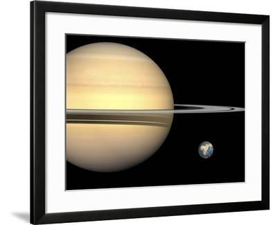 Illustration of Saturn and Earth to Scale-Stocktrek Images-Framed Photographic Print