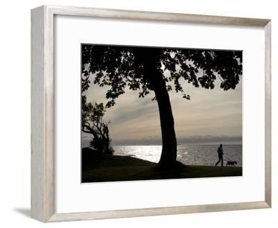 Dog Walker Along Visby Harbor-Keenpress-Framed Photographic Print