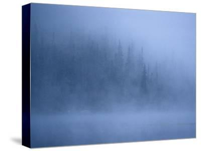 Morning Mist Rises Off a Lake in Algonquin Park in Central Ontario-Kenneth Ginn-Stretched Canvas Print