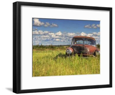 A 1950 Chevrolet Styleline Deluxe 4-Door Sedan Sits Idle in a Field-Pete Ryan-Framed Photographic Print