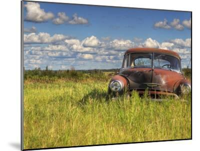 A 1950 Chevrolet Styleline Deluxe 4-Door Sedan Sits Idle in a Field-Pete Ryan-Mounted Photographic Print
