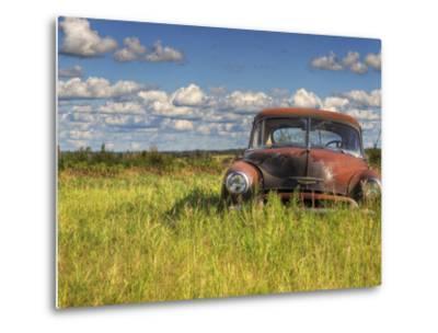 A 1950 Chevrolet Styleline Deluxe 4-Door Sedan Sits Idle in a Field-Pete Ryan-Metal Print