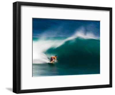 A Surfer Pulls into the Barrel on a Big Day at Uluwatu-Ben Horton-Framed Photographic Print