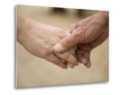 Close-Up of a Couple Holding Hands-Joel Sartore-Metal Print