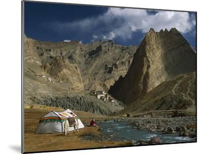 Trekker Writes in Diary Beside Tibetan Tent, Photoskar Village, Ladakh, Himalayas, Northwest India-Colin Monteath/Minden Pictures-Mounted Photographic Print