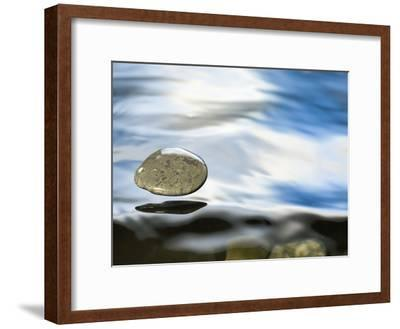 Skipping Stone Just About to Hit the Water's Surface-Michael Durham/Minden Pictures-Framed Photographic Print