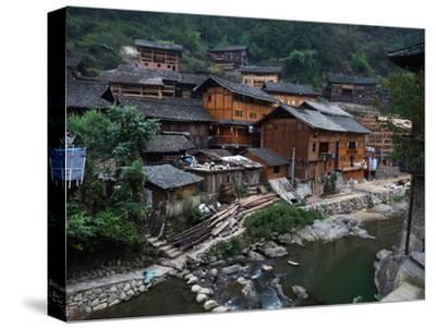 Wooden Houses Line the Duliu River in Xijiang-O^ Louis Mazzatenta-Stretched Canvas Print