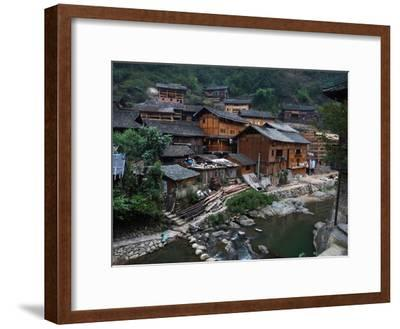 Wooden Houses Line the Duliu River in Xijiang-O^ Louis Mazzatenta-Framed Photographic Print