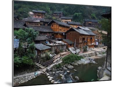Wooden Houses Line the Duliu River in Xijiang-O^ Louis Mazzatenta-Mounted Photographic Print