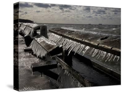 Windblown Icicles Coat a Pier on a Chesapeake Bay Winter Day-Stephen St^ John-Stretched Canvas Print