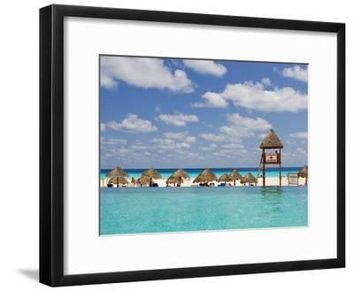 The Caribbean Sea, Tiki Huts and a Lifeguard Stand from a Resort Pool-Mike Theiss-Framed Photographic Print