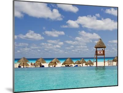 The Caribbean Sea, Tiki Huts and a Lifeguard Stand from a Resort Pool-Mike Theiss-Mounted Photographic Print