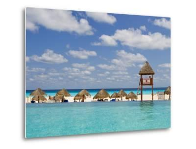 The Caribbean Sea, Tiki Huts and a Lifeguard Stand from a Resort Pool-Mike Theiss-Metal Print