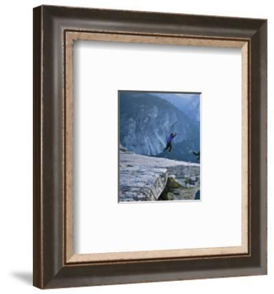 Climbers BASE jump from Half Dome and hike down the back of the mountain.-Jimmy and Lynsey Chin and Dyer-Framed Photographic Print