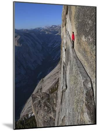 A climber walks a 40-foot-long sliver of granite on Half Dome, named the Thank God Ledge.-Jimmy Chin-Mounted Photographic Print