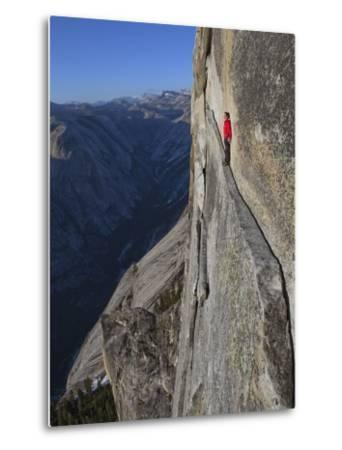 A climber walks a 40-foot-long sliver of granite on Half Dome, named the Thank God Ledge.-Jimmy Chin-Metal Print