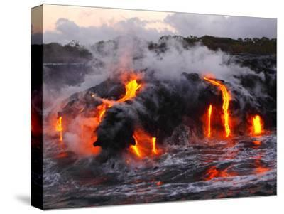 Hot Magma Spills into the Sea from under a Hardened Lava Crust-Patrick McFeeley-Stretched Canvas Print