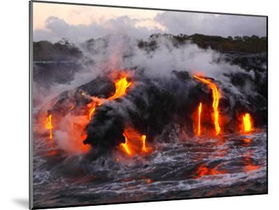 Hot Magma Spills into the Sea from under a Hardened Lava Crust-Patrick McFeeley-Mounted Premium Photographic Print