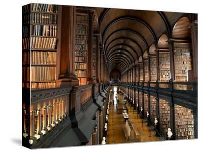 The Long Room in the Old Library at Trinity College in Dublin-Chris Hill-Stretched Canvas Print