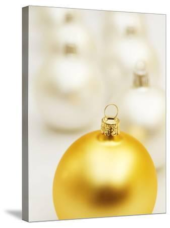 White Christmas tree decorations and a yellow one--Stretched Canvas Print