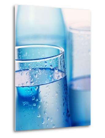 Bottle and glasses of water--Metal Print