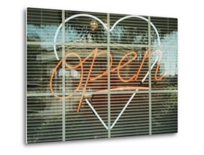 Neon 'Open' sign framed in a heart-shape in a window--Metal Print