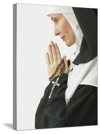 Praying Nun Holding Rosary--Stretched Canvas Print