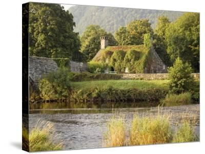 Vine-Covered Stone Cottage Near River Conwy-Richard Klune-Stretched Canvas Print