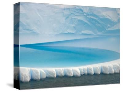 Stranded Iceberg in Shallow Bay Near Boothe Island-John Eastcott & Yva Momatiuk-Stretched Canvas Print