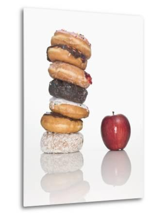 Stack of Donuts and One Apple--Metal Print